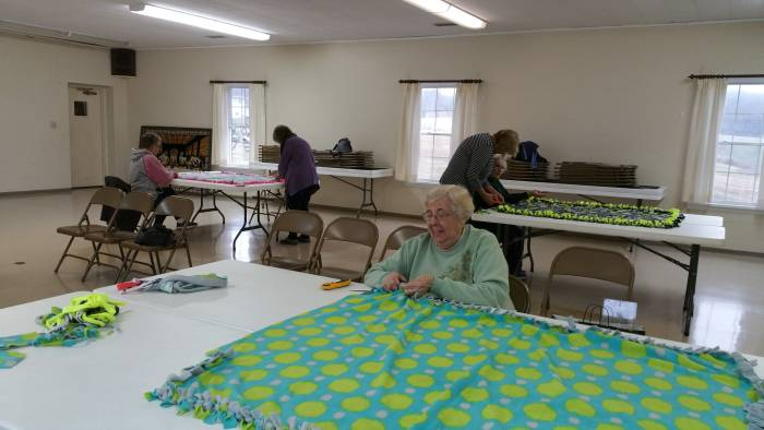 Working on the Blankets of Love mission at the Paoli United Methodist Church.