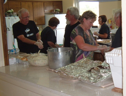 Members in the church kitchen prepare food for the annual Samaritan Fund benefit dinner.