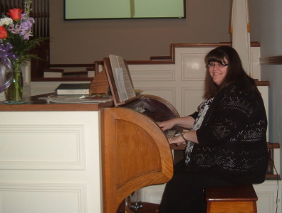 Sara Barnett Seidner playing the Pilcher pipe organ at the Paoli United Methodist Church.