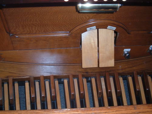 Pedals and swell and crescendo of the pipe organ.