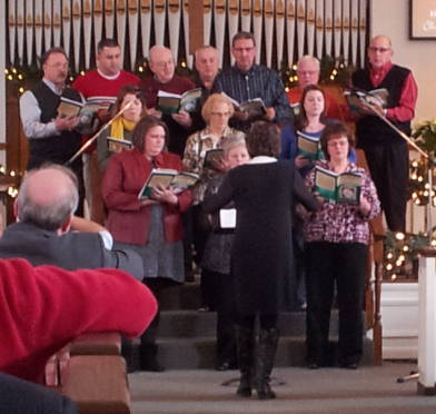 The chancel choir singing a cantata during the service at the Paoli United Methodist Church.
