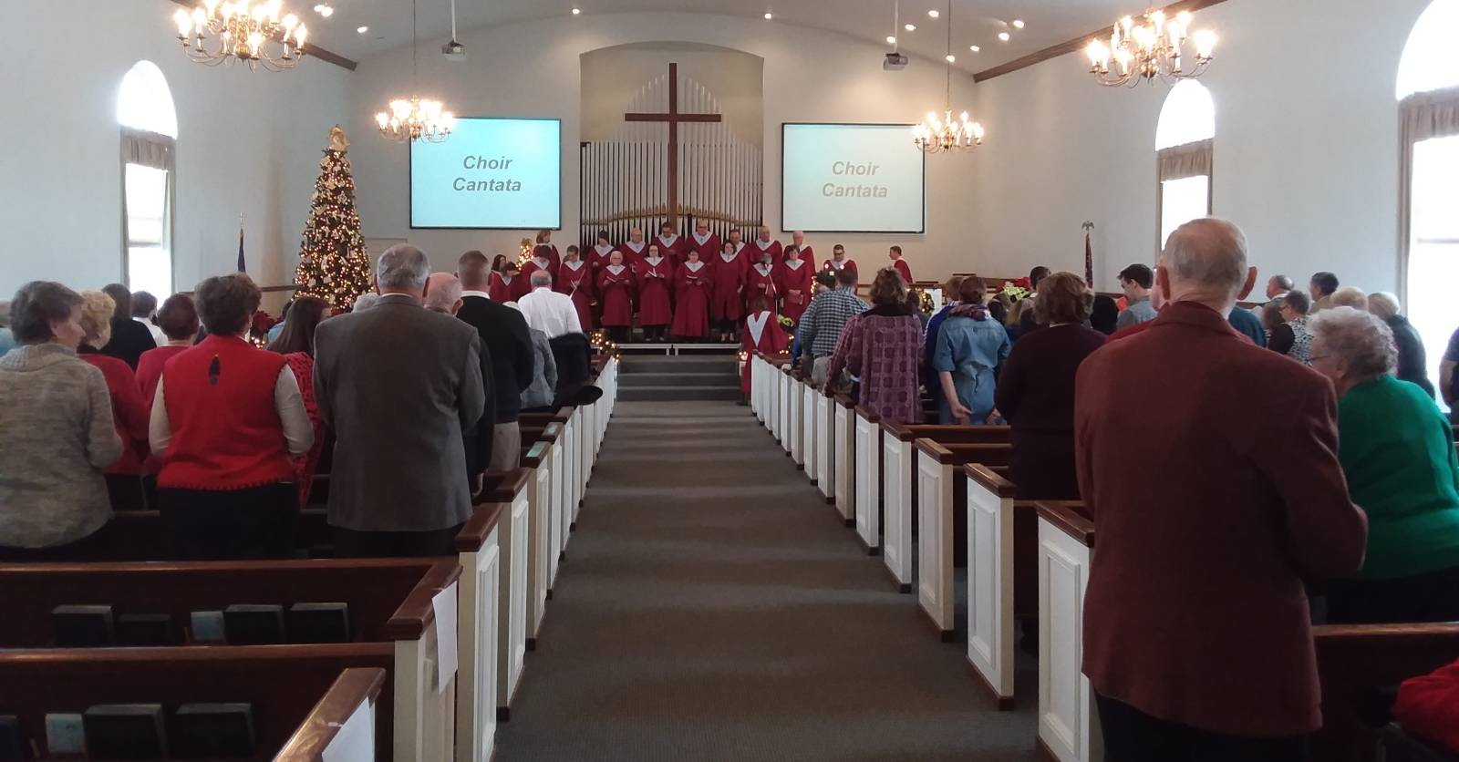 The choir performs a Christmas cantata at the Paoli United Methodist Church.