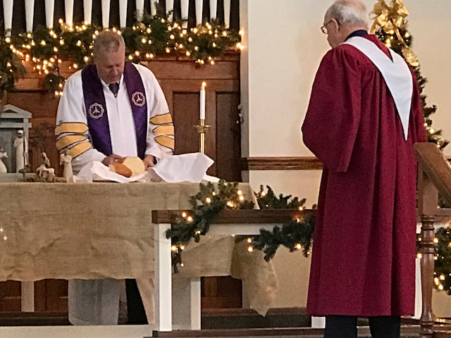 The pastor prepares Communion at the Paoli United Methodist Church during a Sunday morning worship service.