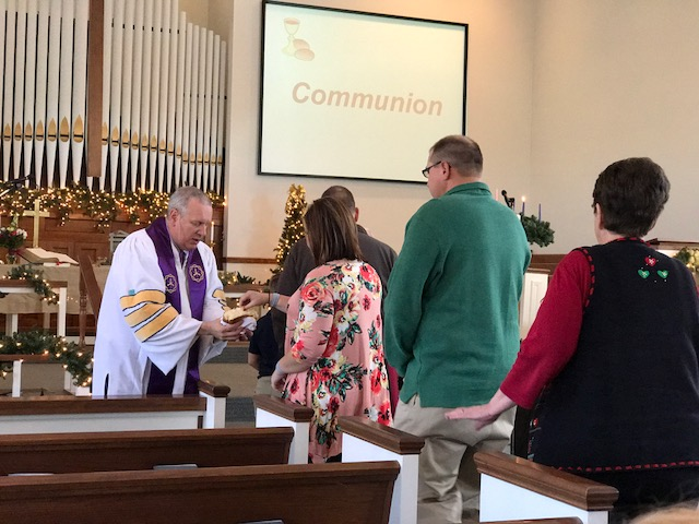 The congregation takes Communion at the Paoli United Methodist Church.