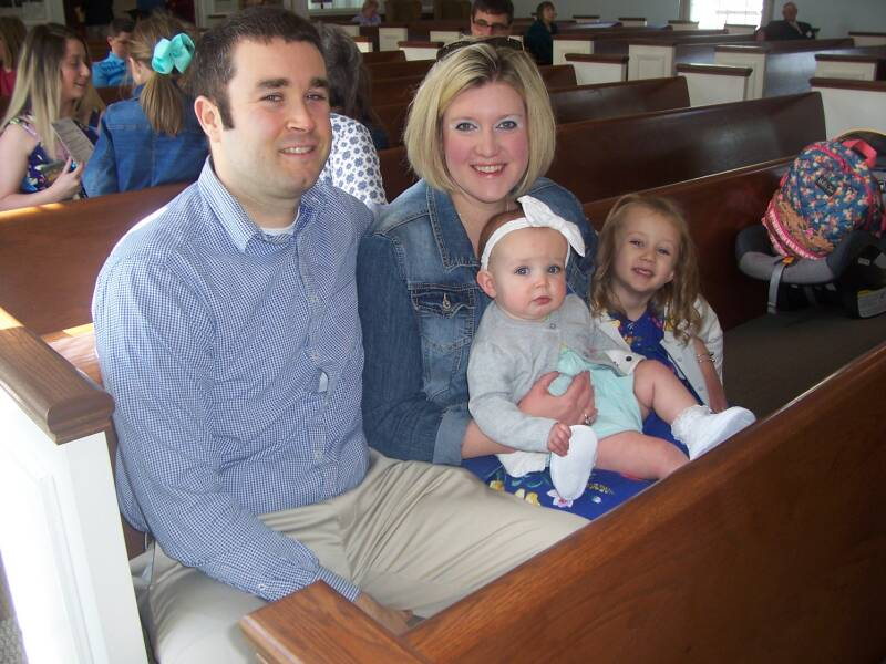 A young family attending a worship service at the Paoli United Methodist Church