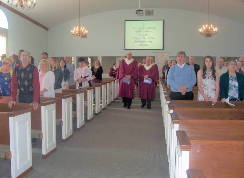 The choir enters the Easter worship service at the Paoli United Methodist Church