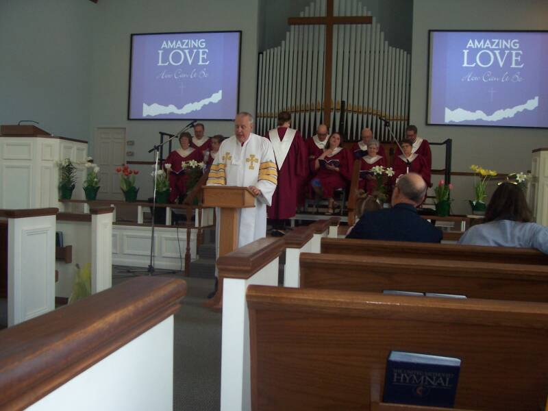 The pastor and the choir at the Easter worship service at the Paoli United Methodist Church