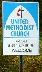 Highway sign: Paoli United Methodist Church 1 mile ahead on the left, Welcome!