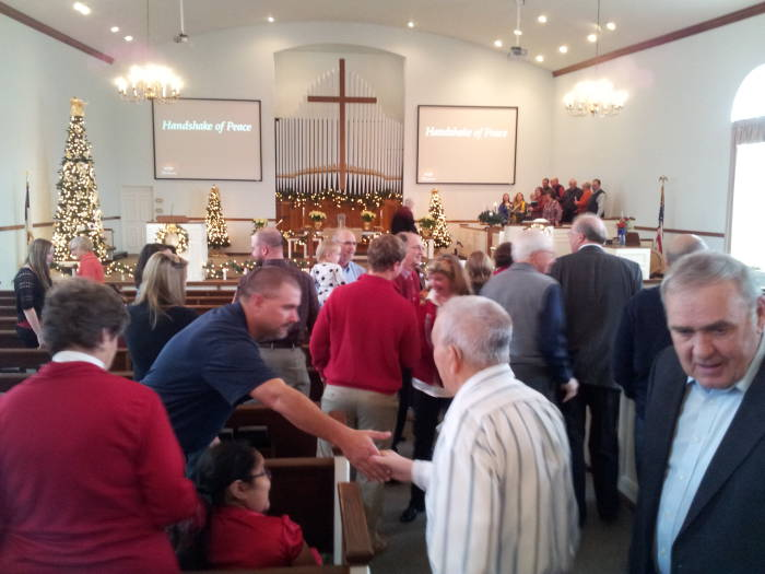 Passing a sign of peace during the service at the Paoli United Methodist Church.