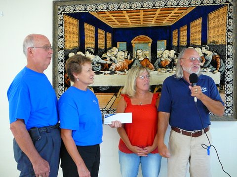 Skip and Martha Lambdin accept a donation from the motorcycle ride organized by Bob and Anita Seybold of Paoli Peaks, August 2012.