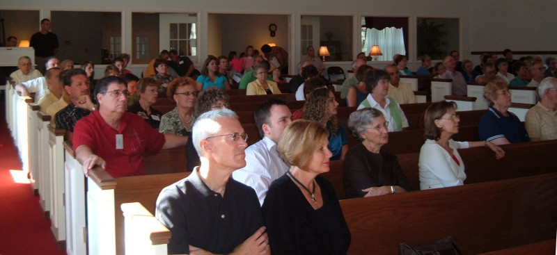 Sanctuary of the Paoli United Methodist Church during a Sunday morning worship service.