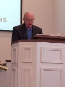 Howard Detweiler reads scripture during a worship service at the Paoli United Methodist Church.