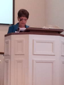 Donna Bonath reads scripture during a worship service at the Paoli United Methodist Church.