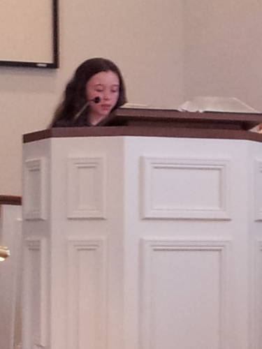 Maggie Vincent reads scripture during a worship service at the Paoli United Methodist Church.