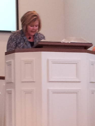 Dee Ann Harmon reads scripture during a worship service at the Paoli United Methodist Church.
