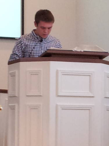 Connor Henderson reads scripture during a worship service at the Paoli United Methodist Church.